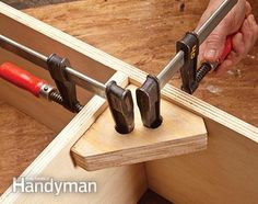 Using a right angle clamping jig to hold cabinet parts together when gluing.