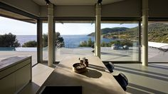 Notre Ntam', a private residence in Agios Fokas, Greece that is open to the greater outdoors by Z-level