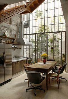 Floor to ceiling windows and patio doors. Rustic kitchen