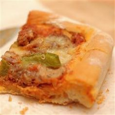 Jay's Signature Pizza Crust Allrecipes.com...Make the dough in the bread maker and then shape and bake. Yum!