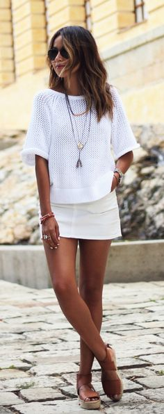 Julie Sarinana is wearing a white crochet top and mini skirt from Armani Exchange and the espadrilles are from Vince