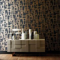 A delightful throwback to the 60s! This Harlequin Asuka Wallpaper design of brush-stroked, interlocking rectangles is depicted in metallics bronzes and coppers. Available from www.silkinteirors.com.au #wallpaper #wallpaperforwalls