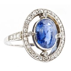 Sapphire Diamond Gold Ring. A sapphire, diamond 14k gold ring from the Edwardian era. The sapphire has been graded by GIA as Ceylon origin with no indications of heating. Approximate weight of the sapphire is 5 carats.
