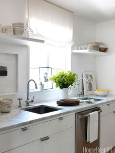 In your all-white kitchen, your dishes sit on open shelving