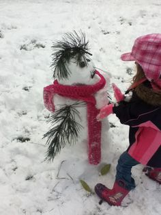 Our crazy haired snow girl