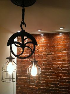 Re-purposed farm well-wheel industrial light