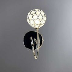 This contemporary chrome wall light fitting features a spherical light fixture with clear glass crystal jewels on the end of a swirling arm. Wall Light Fittings, Light Fixtures, Lighting Sale, Home Lighting, Wall Lights, Ceiling Lights, Wall Mounted Light, One Light, Clear Glass