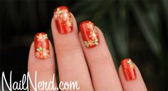 Floral nail art stickers on a base of OPI Deutsch You Want Me Baby?