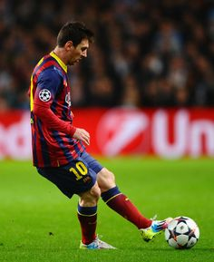Lionel Messi of Barcelona in action during the UEFA Champions League Round of 16 first leg match between Manchester City and Barcelona at the Etihad Stadium on February 18, 2014 in Manchester, England.