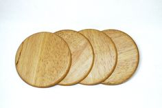 Make any surface where drinks will sit stand out with these awesome rubber wood round coasters. They come in a set of 4 and are finished with a durable topcoat to protect them and make for easy cleaning. Did someone say wine o'clock?!    Approx Dimensions - 10cm x 10cm    Check out our other coasters as well!    As this is a handmade product using the natural colour of the wood, please note that the grain and colour may vary slightly from the sign pictured.
