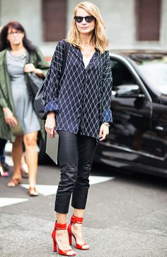 Printed blouse, black leather pants, and red heels