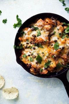 A healthy vegetarian Mexican-inspired dinner -- butternut squash and black bean enchilada skillet!
