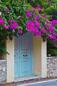 "A "" Welcome Home "" door in Spetses Island"