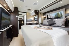Unity motorhome combines Murphy bed and swivel recliners in comfy, flexible lounge