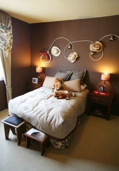 """Its always a good idea to bring the bedrooms """"theme"""" to life!  I love the hats.. but in my sons case It would be a """"sports"""" theme instead of a cowboy theme. I love the different foot stools at the end of the bed also :)"""