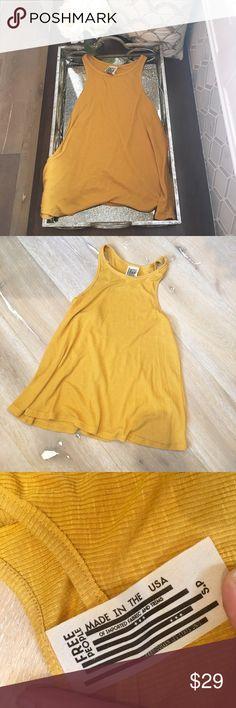 FREE PEOPLE  Tank top size S Beautiful mustard yellow colored flowy tank top. Size small 65% polyester 35% rayon. Worn twice! Happy poshing! ❤ Free People Tops Tank Tops