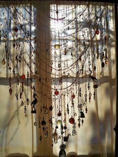 I Love this and (of course) It's on my To Do list....just thread or sew some beads & crystals or any little charms or costume jewellery on a shawl or lace and hang it on your window!