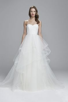 Strapless ballgown with horsehair skirt and detachable train from Nouvelle Amsale. Available in Ivory.