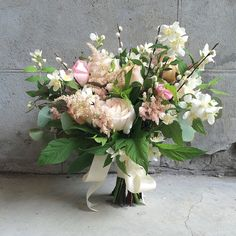 Bridal blooms including local pussy willows, mock orange and pink astilbe. Designed by @tessadawn