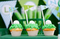 Golf cupcakes with powdered doughnut holes for balls and love the flags