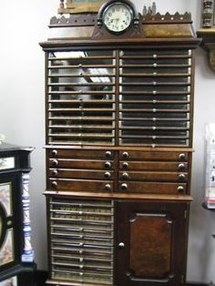 Vintage spool cabinet with New Haven clock.  What an addition this would be to a sewing room!