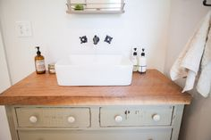 Focus on the Coast Farmhouse Industrial bathroom renovation. Before & After
