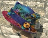 Items similar to Handmade felt hat 'Evolution' MADE to ORDER - Hand dyed felted wool & curls - magical colorful rainbow ARtWeAR ethical fashion wearable art on Etsy Fall Hats, Wool Felt, Felted Wool, Handmade Felt, Textiles, Wearable Art, Ethical Fashion, Etsy, Hat Storage