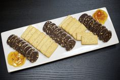 Chocolate Salami Board -- what? made from chocolate ganach with nuts and candied fruits served with salt and pepper shortbread cookies and house marmalade. Olympic Provisions, Candied Fruit, Kielbasa, Bratwurst, Shortbread Cookies, Marmalade, Charcuterie, Ham, Mousse