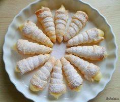 Conos de hojaldre rellenos de crema pastelera | Cocinar en casa es facilisimo.com