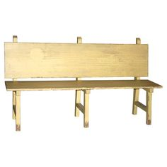 Inspired by vintage school rooms, this reclaimed pine bench features a crackled yellow finish.  Product: BenchConstr...