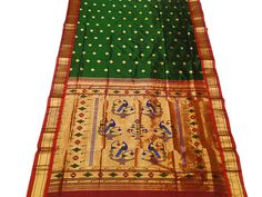 Paithani saree took its name from a place called Paithan, where it started producing 2000 years ago. This saree is made of silk with an ornamented zari pallav and border.