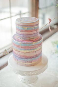 striped wedding cake - photo by Vicki Bartel Photography http://ruffledblog.com/pastel-ontario-wedding-at-sprucewood-shores