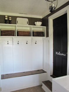 Put your mud room in the garage! Brilliant...except I would never paint anything in my garage white. Just a thought.