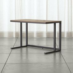 I like this desk for it's simplicity and low profile. Seems like a nice addition to a home office!