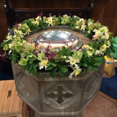 Baptismal font at St. John's, Lafayette, Indiana, with a child's step stool visiible in the lower left. (parish photo on Facebook) Evening Prayer, Photos On Facebook, Floral Arrangements, Flower Arrangement, Easter Flowers, Church Flowers, Church Architecture, Lafayette Indiana, Floral Wreath