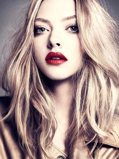 Love her hair,but I really wish I could pull off red lips like that.