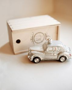 Mini versions of this couple's getaway car were given as favors in boxes sporting their monogram