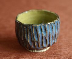 Rocky Smith- I like this pinch pot design because it the carvings make the glaze look cooler in a way