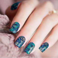 Get a perfectly patterned manicure with our easy-to-use nail wraps! Twinkled T nail wraps are made with 100% nail polish. Directions: 1. Wipe nail clean with acetone.2. Peel appropriate sized wrap and place onto nail.3. Push down wrap from the center of the nail out to the edges, leaving no bubbles.4. Fold excess wrap Best Makeup Tips, Best Makeup Products, Peacock Nails, Nail Polish Stickers, Clean Nails, Acetone, Some Times, Nail Wraps, Blue Nails