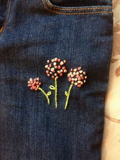 Flowers in french knot detail. Toddler jeans