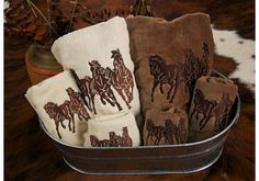 Beautiful embroidered horse towel sets to coordinate with your western or equestrian decor. Mix and match various patterns in two neutral colors, cream or mocha brown.  Super soft and plush with elegant embroidered trim. Most styles have coordinating bedding, shower curtains, sheet sets and dinnerware.