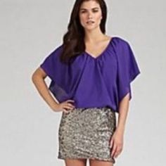 "HP 7/3 Style Obsession Gianni Bini sequined mini Gianni Bini Sequin Bottom Club/Mini Dress MSRP: $149.00 • Purple Top: 95% Polyester 5% Spandex • Gold/Silver Sequins Skirt: 100% Polyester Lining • Open, flowing sides with fitted layer underneath • fitted bottom • 33"" total length • size Small (S) • will fit sizes 0-4 (possibly a smaller size 6 as well), in my opinion • Great dress! Gianni Bini Dresses"