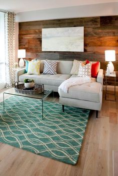 how to style toss cushions on a couch. Living room decorating and decor ideas with a rustic wood wall #style #LivingRoomDecor