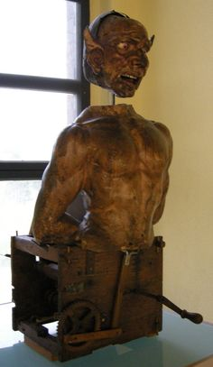 "Italian Automaton (The Devil), carved in wood, 15th and 16th centuries,it could ""roll its eyes and move its tongue, emit a noise and spit smoke from the mouth."""