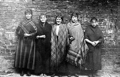 A group of women from the Calton, early 20th century. These women are wrapped up warm in their shawls. Woolen shawls had been common outerwear for women in rural areas of Scotland for generations. They became fashionable among working-class Glasgow women during the mid-late 19th century, as mills in the city and in towns such as Paisley mass-produced these simple, often colourful garments for sale at relatively low prices.