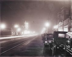 Delmar Boulevard west from Eastgate. Night view of Tivoli Theatre. (1935) Missouri History Museum