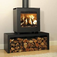 Westfire-23-Woodburning-Stove Stand 80% efficiency, £880, Table stand W1000mm x D450mm x H400mm for 50mm leg models £244 - wonder if you could use the stand for other stoves, I like the way it looks and it's a very practical log store.