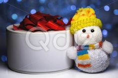 Qdiz Stock Photos | Christmas snowman toy with gift box or present,  #background #beautiful #beauty #blue #blur #blurred #box #celebration #Christmas #closeup #color #colorful #decoration #decorative #doll #eve #figure #fun #funny #gift #greeting #hat #holiday #light #little #Merry #new #object #package #present #red #ribbon #scarf #small #snowman #surprise #toy #traditional #white #xmas #year