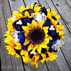Rustic sunflowers with Navy flowers and baby's breath.