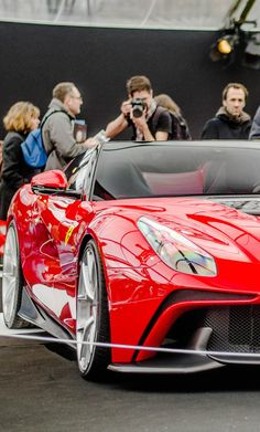 Ferrari F12 TRS... MY dream car! By far and away without shadow of doubt the best looking Ferrari EVER! The paint job is awesome, dripping red paint!